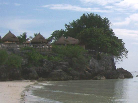 Alona Tropical Beach Resort: beachfront and view of Crystal HIlls Resort