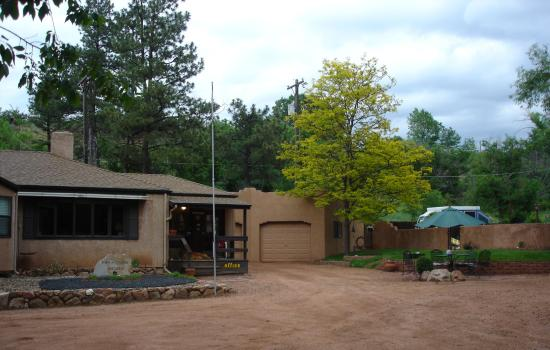 Town-N-Country Cottages: view of office on left and gated pool/hottub area on right