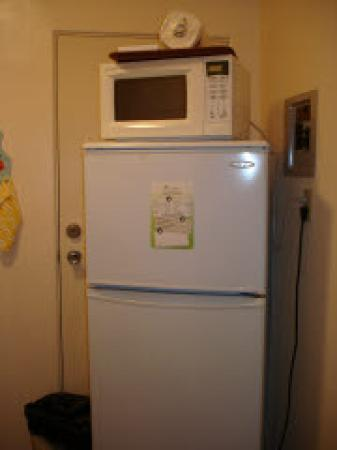 Clairfont Apartments: Fridge and Microwave