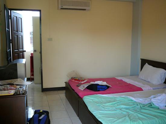 T-Room Guesthouse: The room. Very spartan with hard beds! Not as glam as on their website.