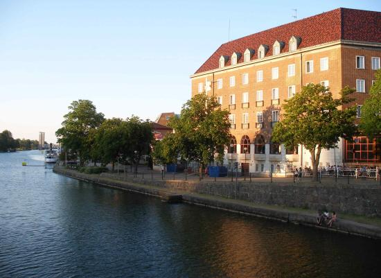 Scandic Swania: Canal side of hotel, with outside cafe to the lower right.