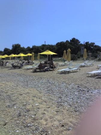 Anassa Hotel: beach umbrellas run by the 9 muses next door