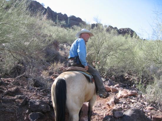 White Stallion Ranch: wrangler on a mountain ride