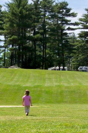 Normandy Farms Family Camping Resort: A walk from the pond near the baseball diamond