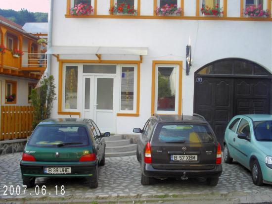 Restaurant-Pensiunea Joker: Outside the restaurant (hotel to the left)