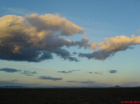Inverdoorn Game Reserve: Clouds over the plain at sunset