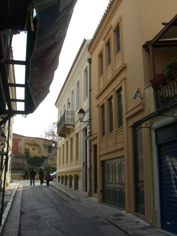 a road with neoclassical buildings in Plaka neighbourhood