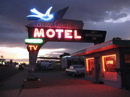 Blue Swallow Motel: Blue Swallow office with neon sign lit.