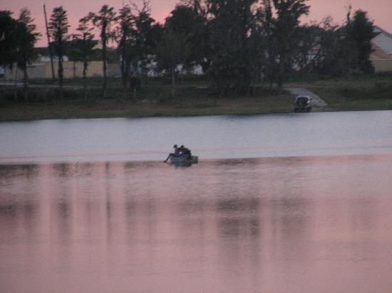 Grand Lake Resort: row boat in lake at sunset