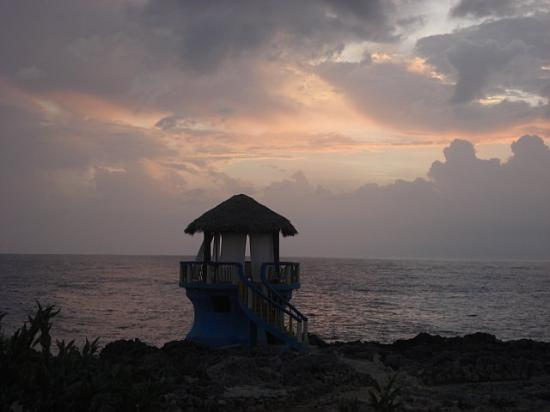 Negril Escape Resort & Spa: View of hut at sunset from balcony