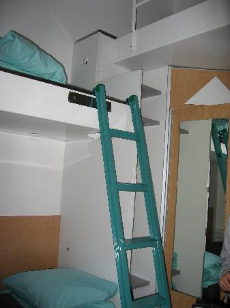 Hotel CABINN Scandinavia: The bunked beds, and the lofted one is on the right.
