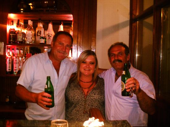Captains Hotel: Manos me & Hussan his friend having a drink behind the bar