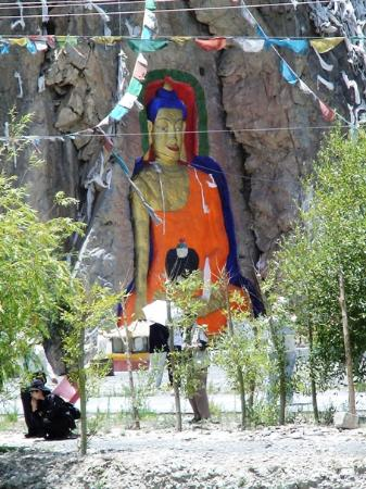 Tibet, China: Buddha Statue Carved from Cliff