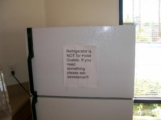 Americas Best Value Inn Phoenix/I-10 West: Refrigerator with warning sign: Is this where they keep the good stuff?