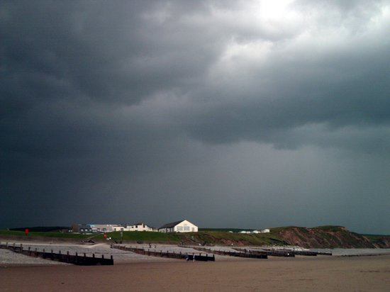 St. Bees, UK: Storm clouds over the beach shop
