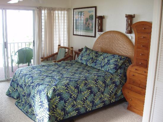 Kapaa Sands: The bed and cute 'ukelele dresser.
