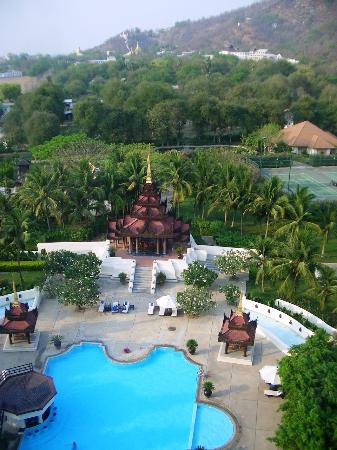 Mandalay Hill Resort : Pool, outdoor dining & tennis court with Mandalay Hill beyond