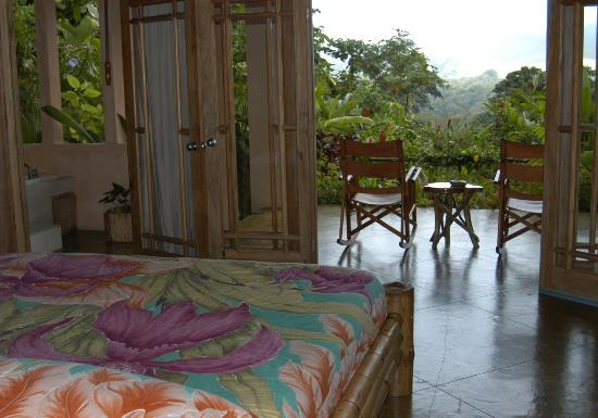 Lost Iguana Resort & Spa: A king size bed, a private balcony & a Jacuzzi all with a volcano view