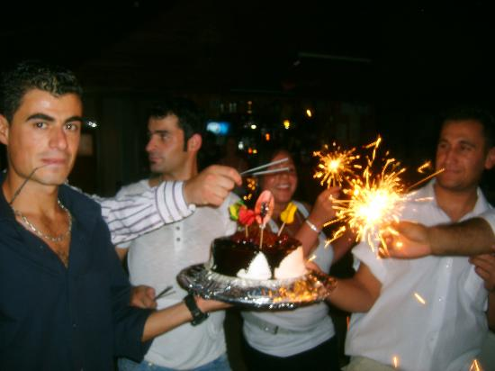 Hotel Olive Garden - Ovacik: Nassim, Elvis, Naomi and Sinbet bringing out our cake as a present