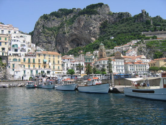 Boats ready to depart on Amalfi pier