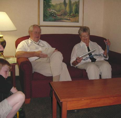 Comfort Suites Burlington: Grandma & Grandpa getting presents in the suite