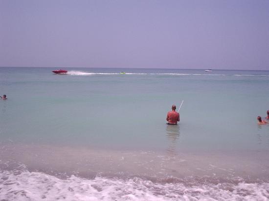 Cinnamon Beach at Ocean Hammock Beach Resort: Boating & family member looking for shells/ shark teeth