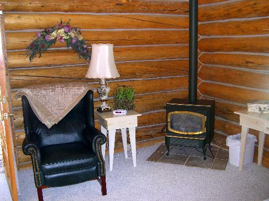The Old Mill Log Cabins : Want to start a fire and cozy up with a book?