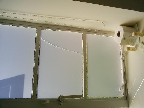 Feathers Inn: Cracked Window Pane