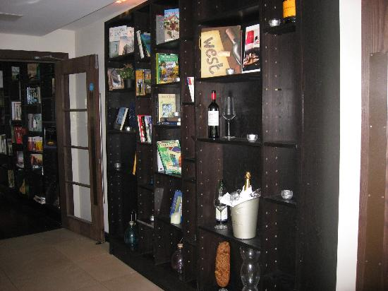 The Twelve Hotel: Cool bookshelves leading into Pins - these were filled with lit candles in the evening and...