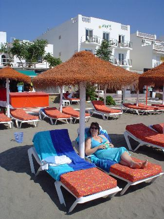 La Carihuela: Beach sunbeds with apartments in background
