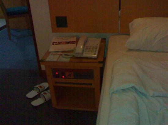 Hotel Mega Anggrek: Bedside table with TV remote built in