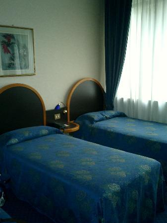 Hotel Tiziano - Gruppo Mini Hotel: Chambre (un troisième lit non visible)