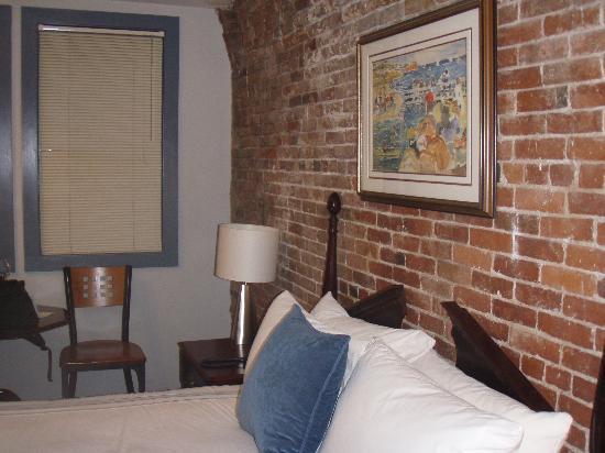 Harborside Inn : Original brick wall.  Beautiful