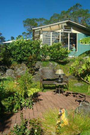 Volcano Guest House formal garden sitting area, and greenhouse with hot tub