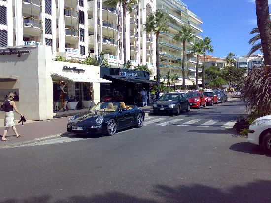 Eden Hotel & Spa: An example of the cars and shops in Cannes - A Porsche and Dolce and Gabbana