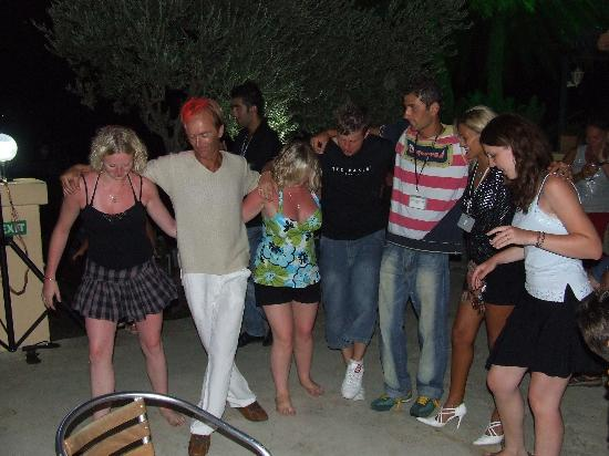 Torba, Turcja: Us dancing with entertainment team around bar to live music