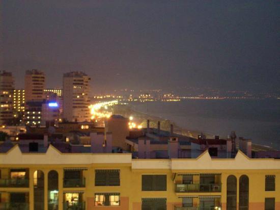 Bajondillo Apartments: View from balcony at night