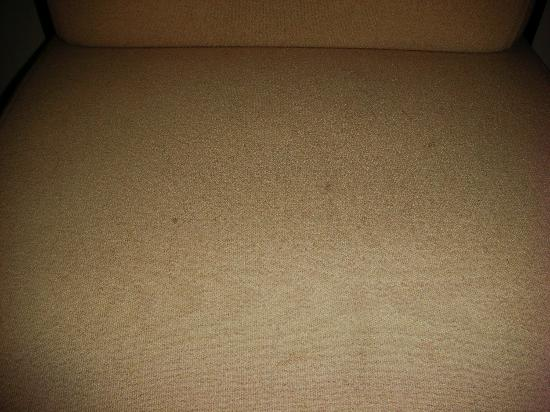 Maximilian Hotel: The seat cushion was stained and had someone's hair on it--not mine.