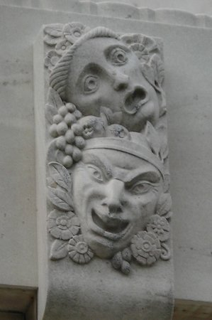 Folger Shakespeare Library : Drama masks outside the theater