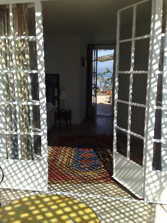 La Tangerina: The view through our room from our private terrace to the rooftop terrace