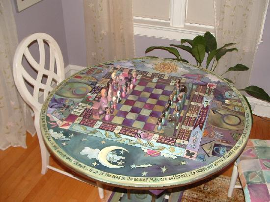‪‪Butler House on Grand‬: The hand painted game table.‬