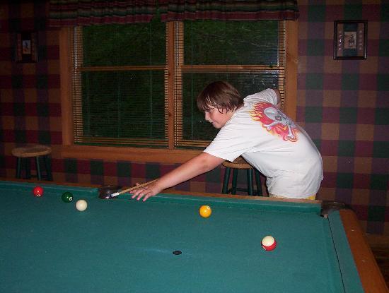 Timberwinds Log Cabins: bday boy playing pool