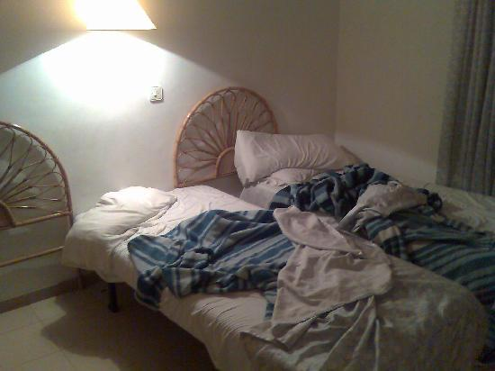 dirty bed linen in bedroom Picture of Lotus Apartments Blanes