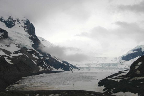 Columbia Icefield Glacier Discovery Centre: small spots on glacier are Icefield tour buses