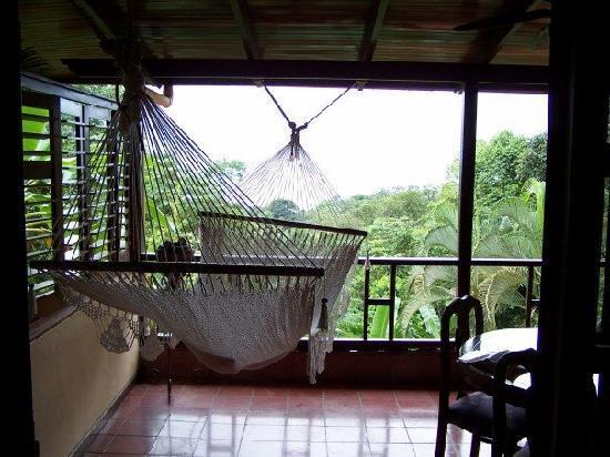 Villas Nicolas: Our verandah - I miss that hammock!
