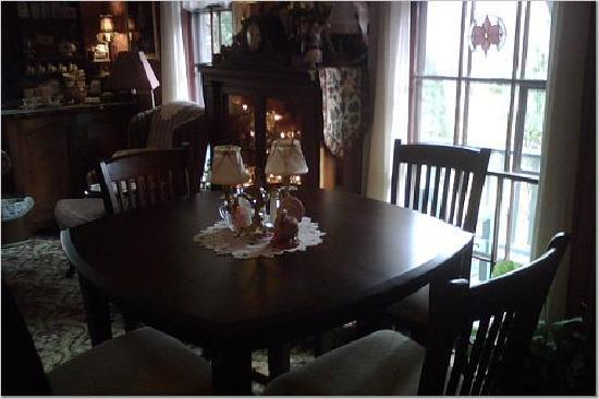 The Jenkins Inn & Restaurant : In the Salon...full bar, table for four, sofa and three chairs. Books and fireplace too.