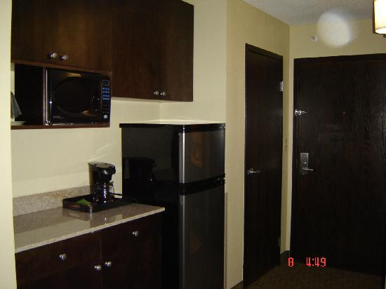 ECCO Suites Augusta: big fridge and microwave inside the room