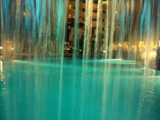 Royal Azur Thalasso Golf : View of pool from inside waterfall cave/bar
