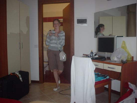Hotel & Aparthotel Sheila: My geeky sister in our room...again excuse the mess