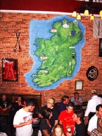 The Harp and Celt Irish Pubs and Restaurant: Map of Ireland in plaster on the brick wall